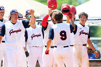 035 - Team Georgia's Dalton Smith (9) is congratulated after hitting a three-run homer against Team Mississippi