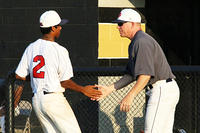 061017-005-Team Georgia coach David Smart, right, congratulates Gavin Patel after Patel and Kelvin Smith turned a 4-6-3 double play against Team Missouri