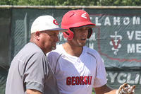 061317-002-Hunter Foster talks with third-base coach Tony Kirkland after a stand-up triple against Oklahoma Blue
