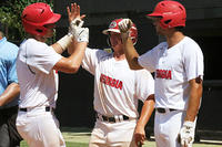 061317-003-Will Patota, left, is met at the plate by Jack Haney and Hunter Foster after smashing a two-run homer against Oklahoma Blue